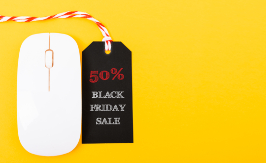 Online shopping Black Friday sale text red tag on white mouse with yellow background