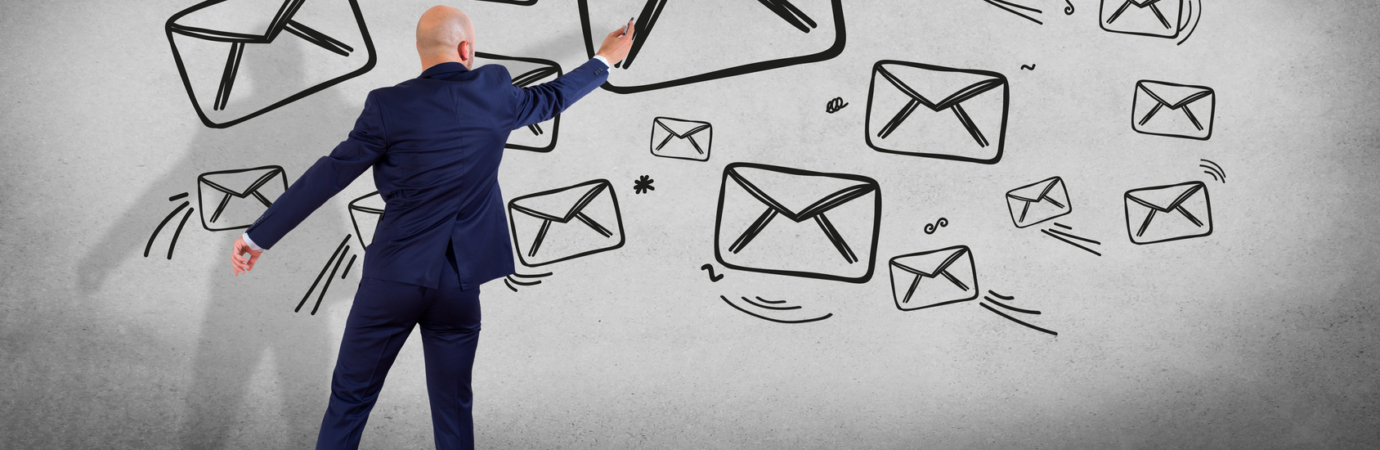 View of a Businessman in front of a wall writing on an email interface - Technology concept