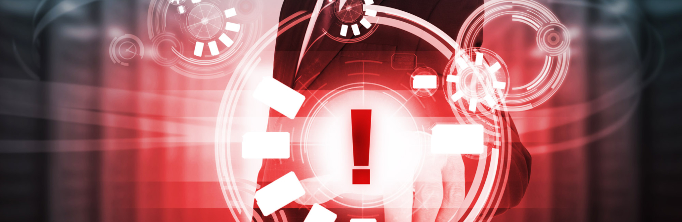 Businessman touching red futuristic warning icon interface in data center